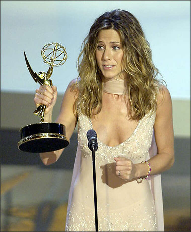 "Jennifer Aniston accepts her Emmy for outstanding lead actress in a comedy series for her work in ""Friends."" The show also won for comedy series. Photo: Associated Press"