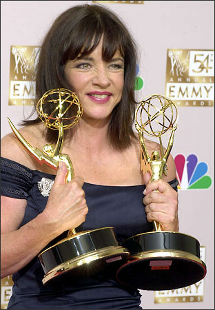 Stockard Channing displays the two Emmys she won last night. Channing won for roles in