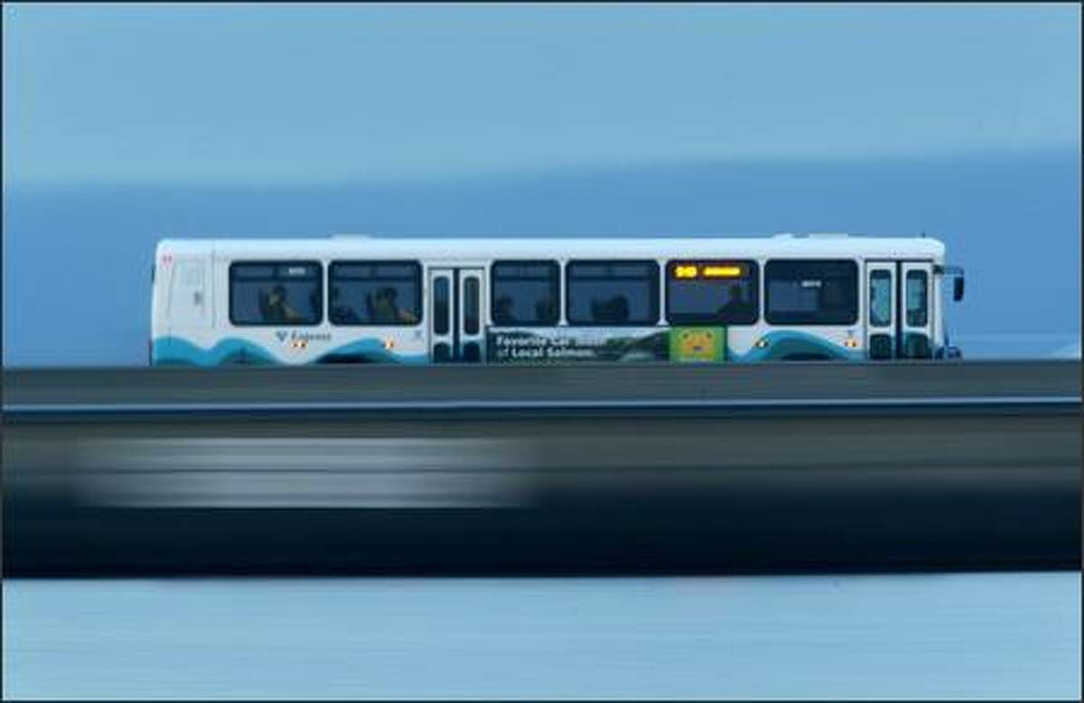 A Sound Transit bus crosses the floating section of the 520 bridge over Lake Washington. The floating bridge is in dire need of replacement, according to transportation officials. The project is seen as a large financial and environmental hurdle in improving local traffic congestion and commutes.