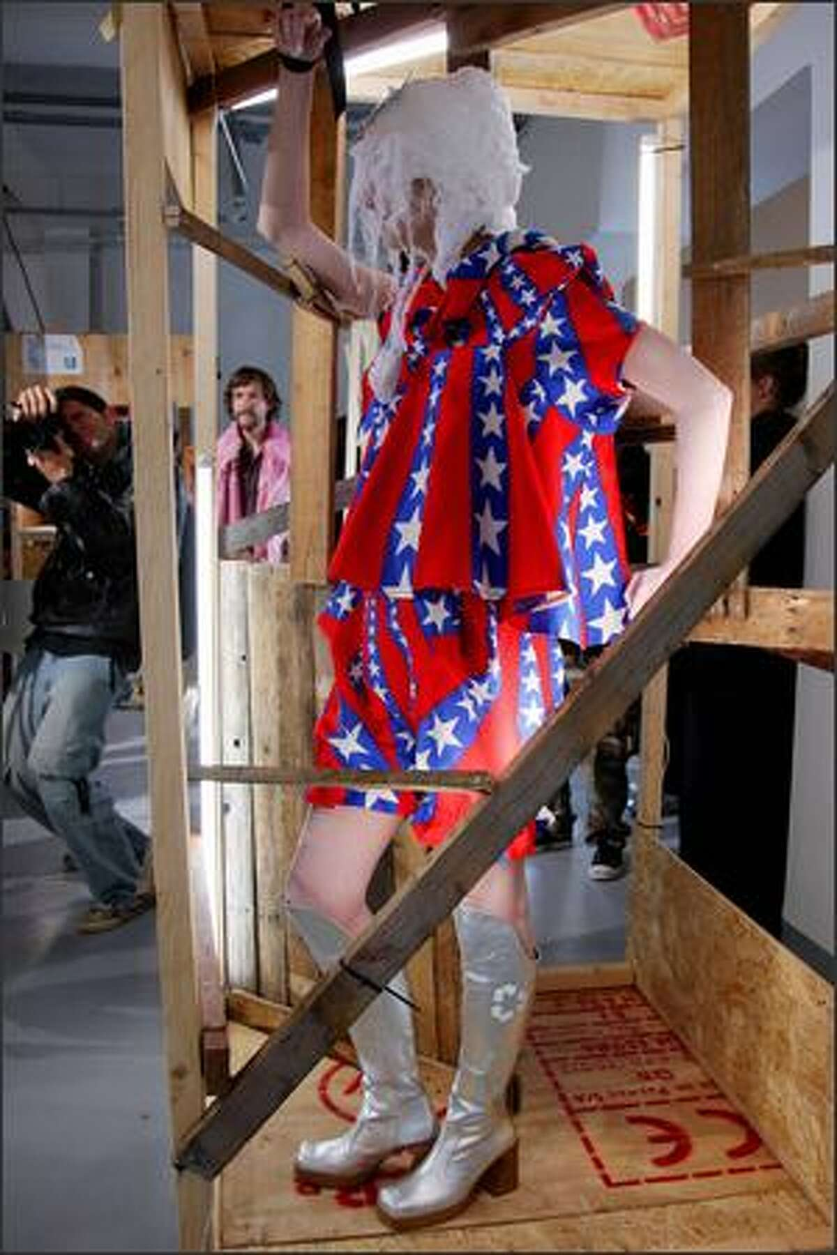 A model presents a creation by German designer Bernhard Willhelm during the Spring/Summer 2008 ready-to-wear collection show in Paris, 30 September 2007. AFP PHOTO PIERRE VERDY