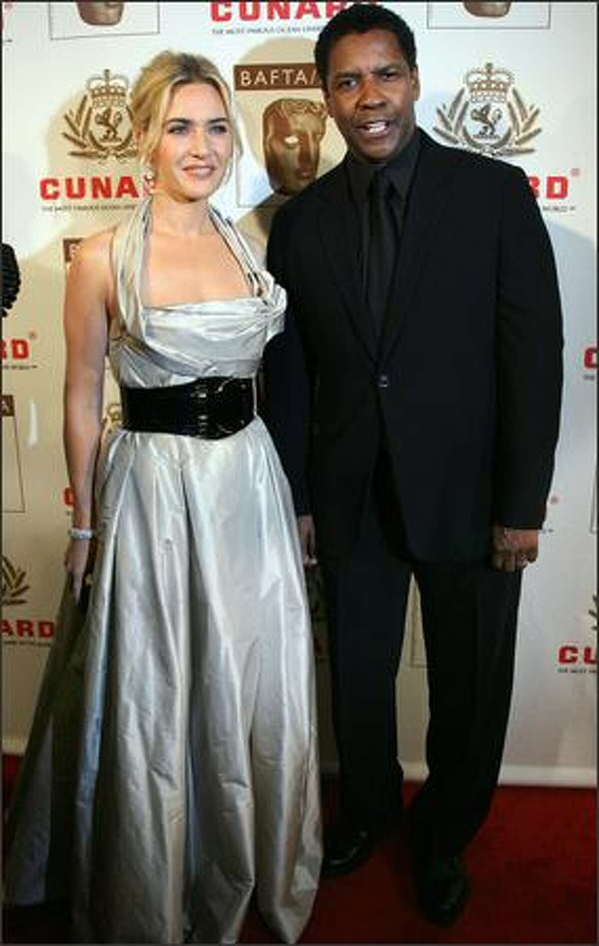 British actress Kate Winslet arrives with actor Denzel Washington at the British Academy of Film and Television Arts/Los Angeles (BAFTA/LA) Awards in Los Angeles, California.