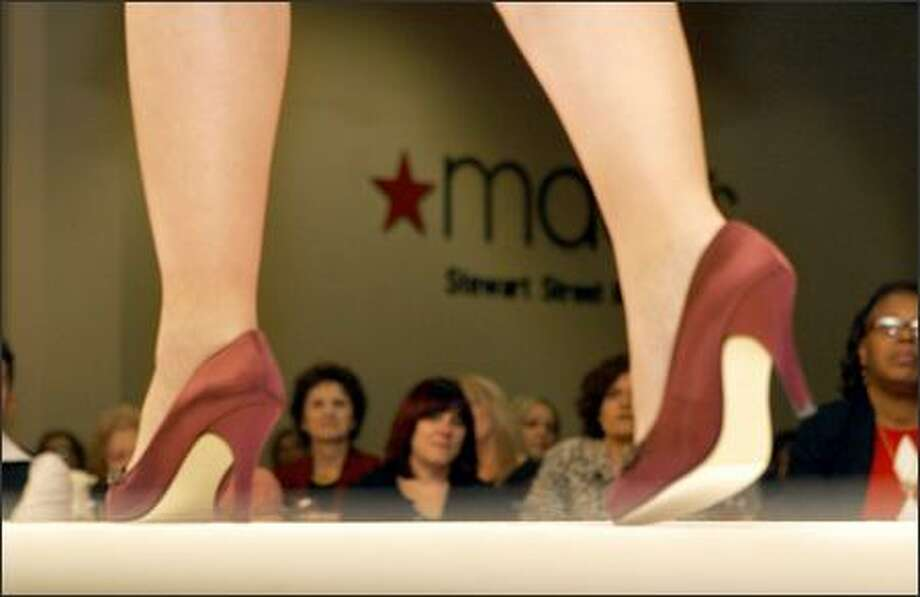 Marie Raposa makes her way down the runway in cranberry satin heels by Caparros at Macy's 11th Annual Breast Cancer Survivor Fashion Show in downtown Seattle where 16 local cancer survivors walk the runway and share their stories with an estimated 400 guests. Money raised by the event went to the Valley Breast Cancer Center. Photo: Amber Trillo, P-I