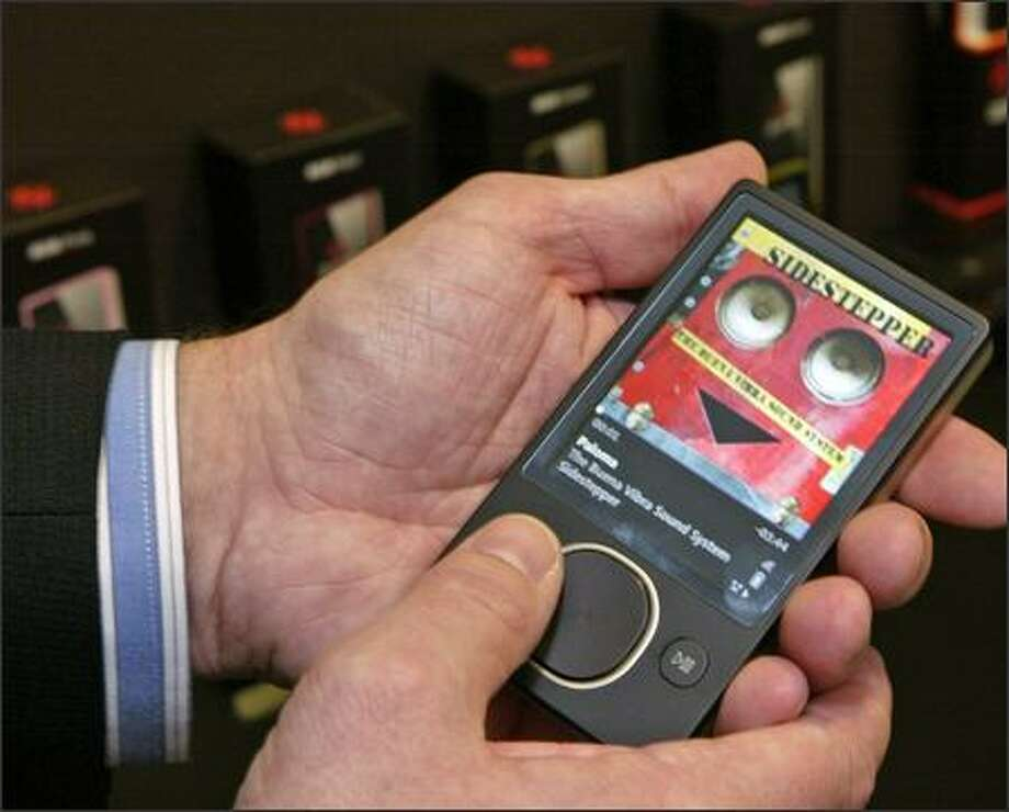 Microsoft's new 80GB Zune media player, which uses a combination touch/push pad for navigation. Photo: Grant M. Haller, Seattle Post-Intelligencer