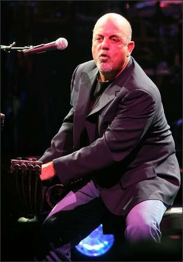 The Piano Man Billy Joel plays Key Arena. Photo: Mike Urban, Seattle Post-Intelligencer
