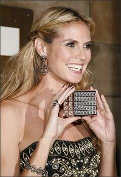 Model Heidi Klum with her award at the 11th Annual ACE Awards at Cipriani in New York City. Photo: Getty Images
