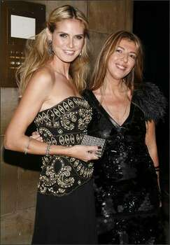 Model Heidi Klum (L) and ELLE Fashion Director Nina Garcia (R) attend the 11th Annual ACE Awards at Cipriani in New York City. Photo: Getty Images