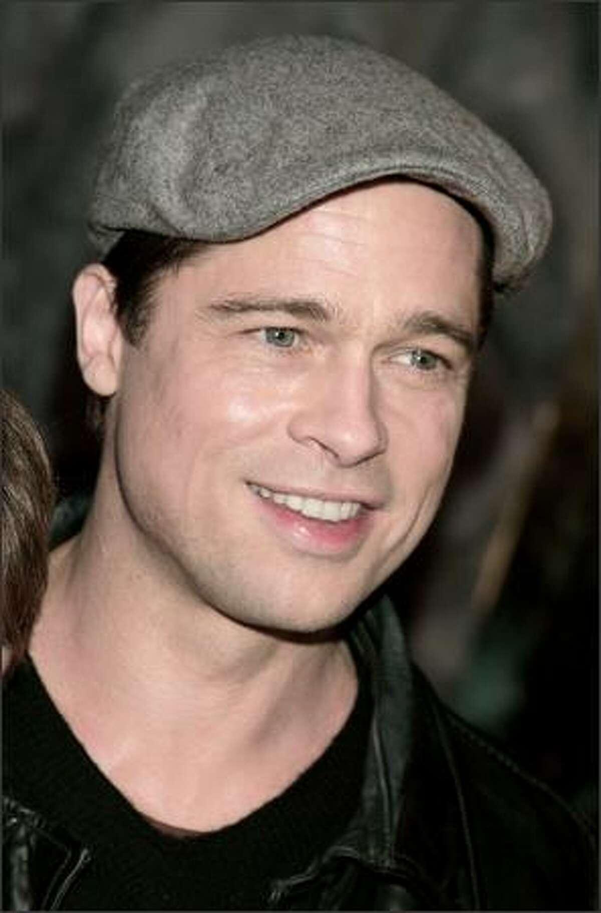 Actor Brad Pitt arrives.