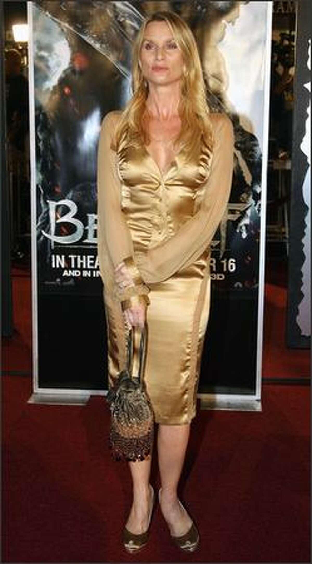 Actress Nicollette Sheridan arrives.