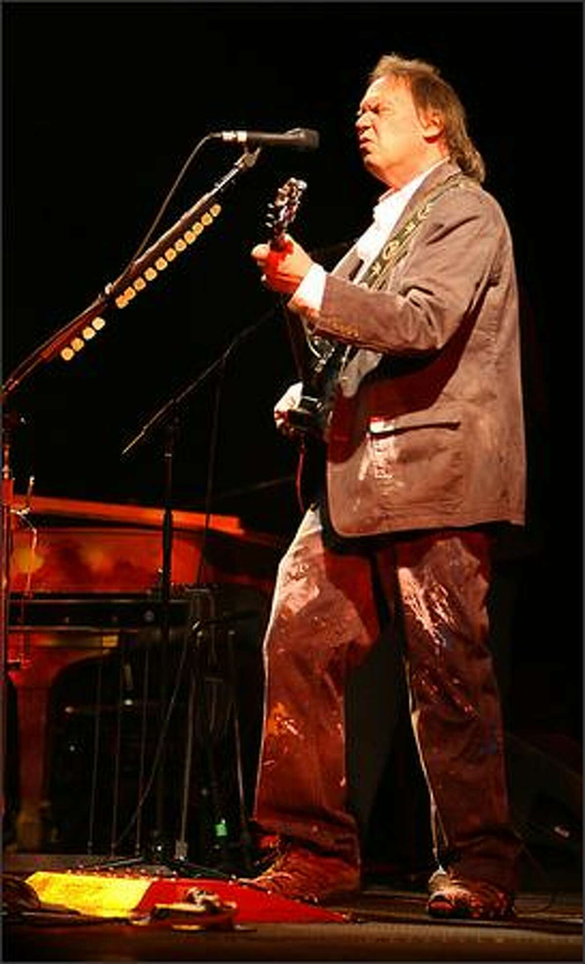 Neil Young performs in the Chrome Dreams Continental Tour at the WaMu Theater in Seattle, Tuesday night October 23, 2007.