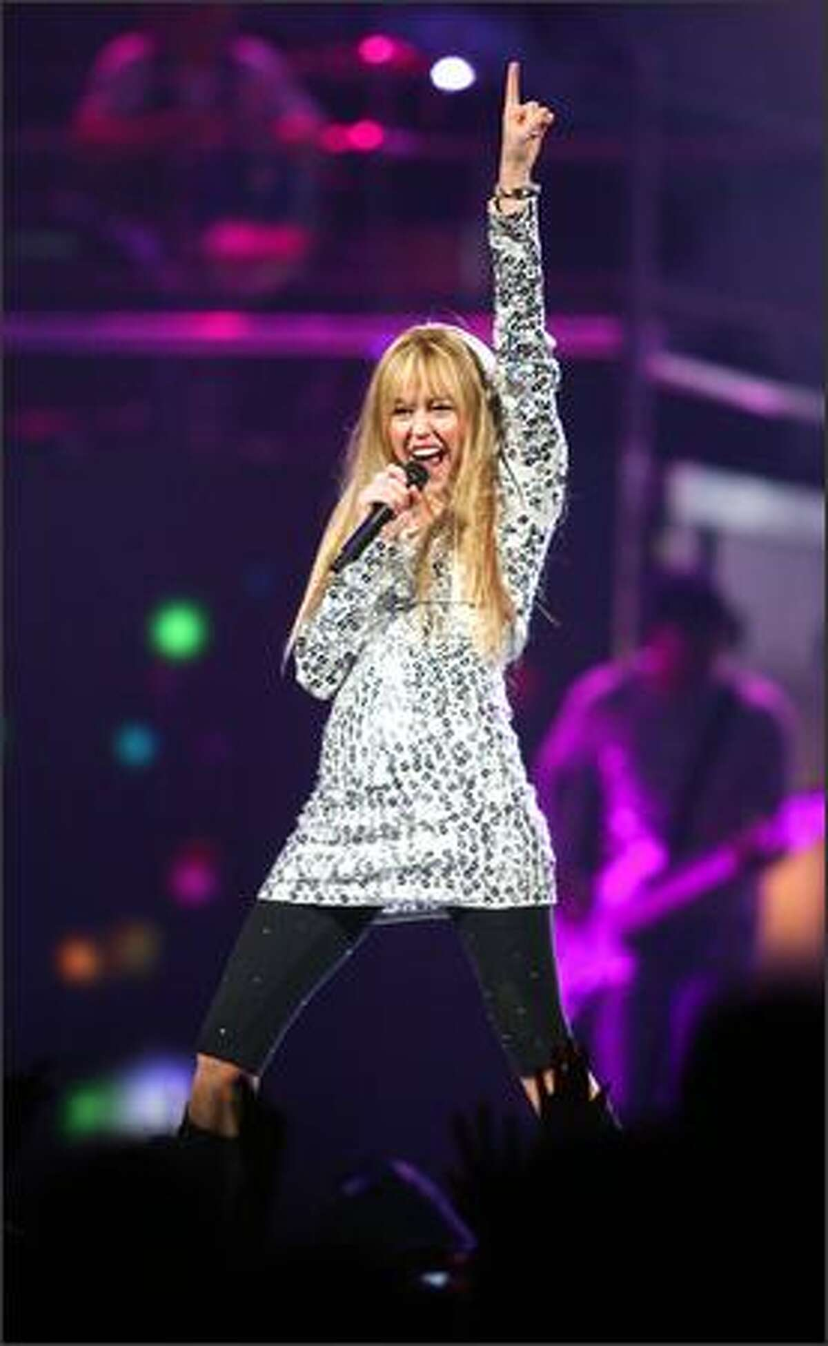 Miley Cyrus aka Hannah Montana performs during her concert at Key Arena.