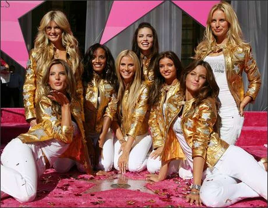 Victoria's Secret Angels pose on the Hollywood Walk of Fame after being honored by a star in front of the Kodak Theater on Hollywood Boulevard to celebrate the 25th anniversary of Victoria's Secret 13 November 2007 in Hollywood, Calif. Photo: Getty Images