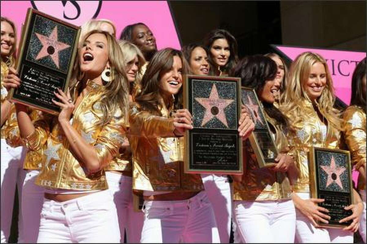 Victoria's Secret Angels pose on the Hollywood Walk of Fame after being honored by a star in front of the Kodak Theater on Hollywood Boulevard to celebrate the 25th anniversary of Victoria's Secret 13 November 2007 in Hollywood, Calif.