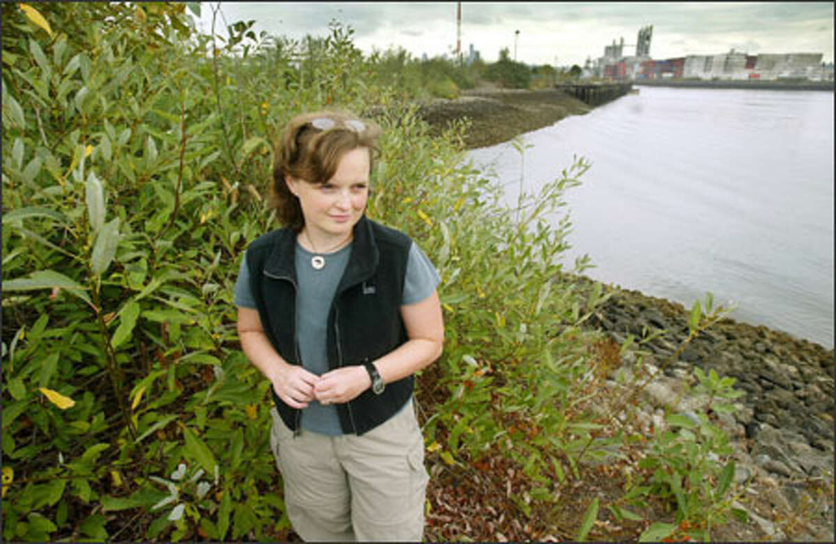 Joy West of People for Puget Sound, seen here at the Duwamish River, says the species act must be enhanced, not eliminated. Environmentalists fear Congress will weaken the law and undo years of protection.