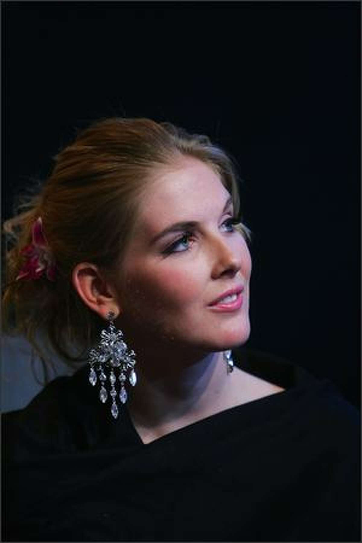 Caroline Pemberton, Miss Australia 2007, looks on in a TV studio on Nov. 20 in Beijing.