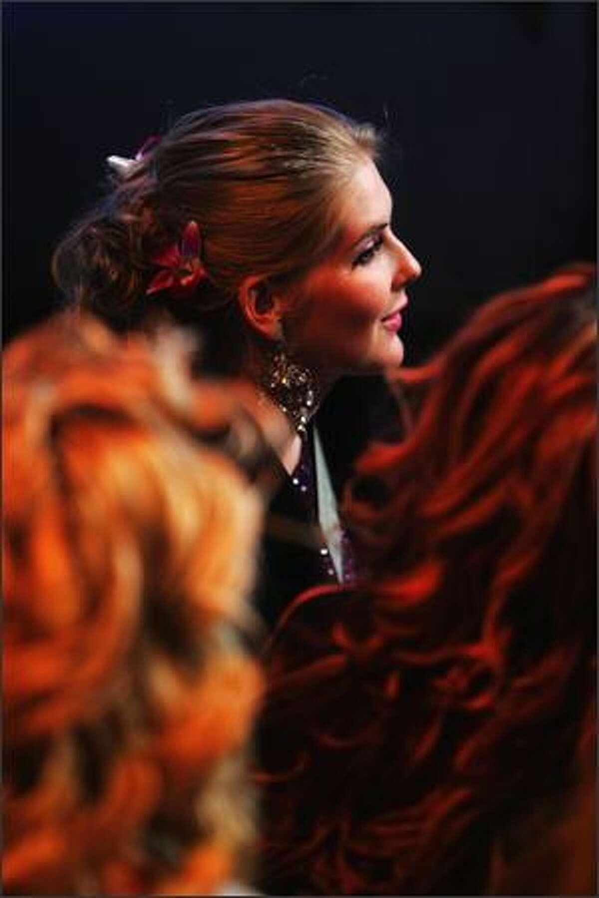 Caroline Pemberton, Miss Australia 2007, looks on in a TV studio.