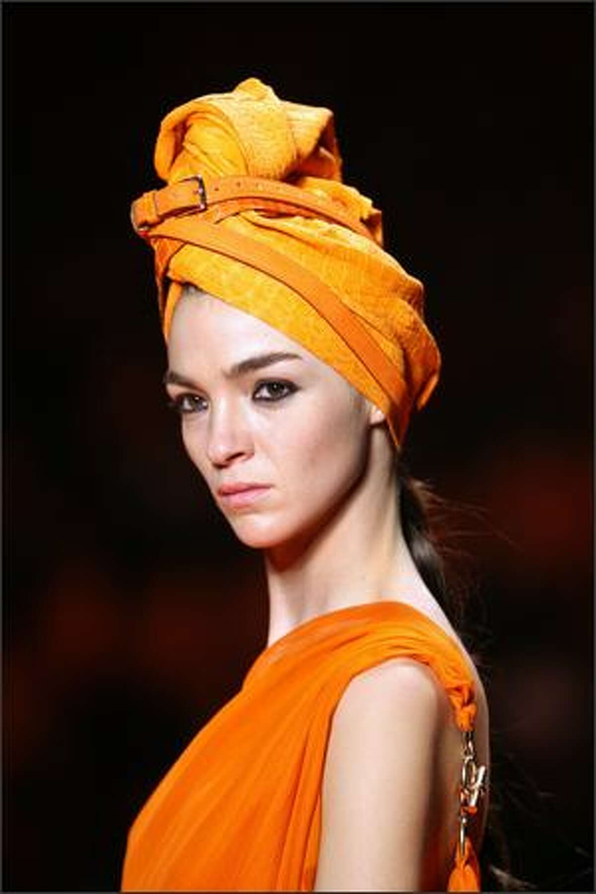 Italian model Maria Carla Boscono presents a creation by French designer Jean Paul Gaultier for Hermes during Spring/Summer 2008 ready-to-wear collection show in Paris, 06 October 2007.