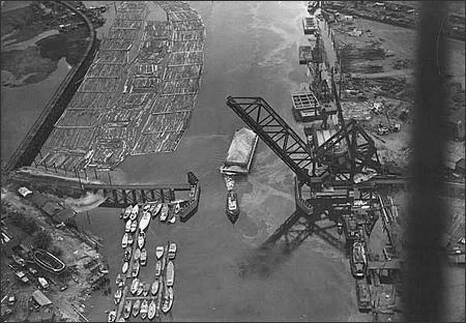 Aerial of Duwamish River and Spokane Street Bridge looking south, Seattle, June 15, 1938. (Charles Laidlaw)