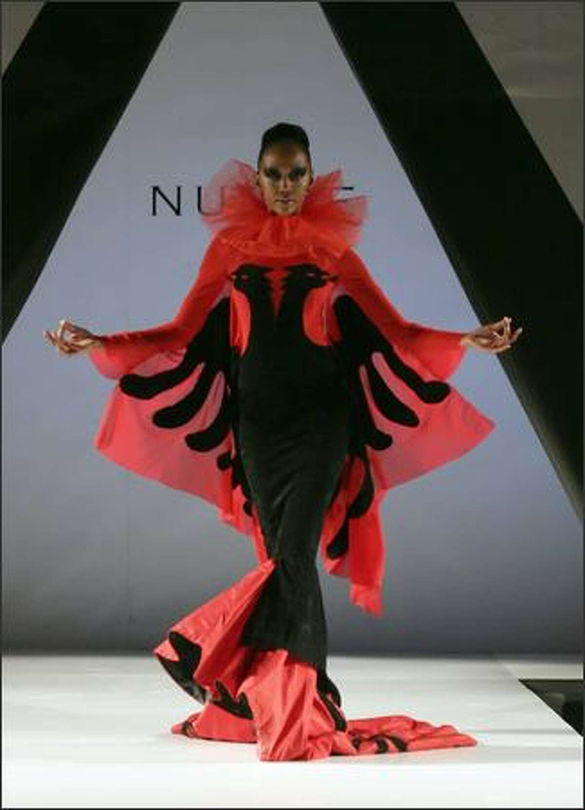 A model wearing a creation of Albanian designer Mirela Nurce walks the catwalk during the first day of 'Tirana Fashion Week' in Tirana, 25 October 2007. Creators from Albania, Kosovo, Macedonia and Greece will take part during this fashion week event.