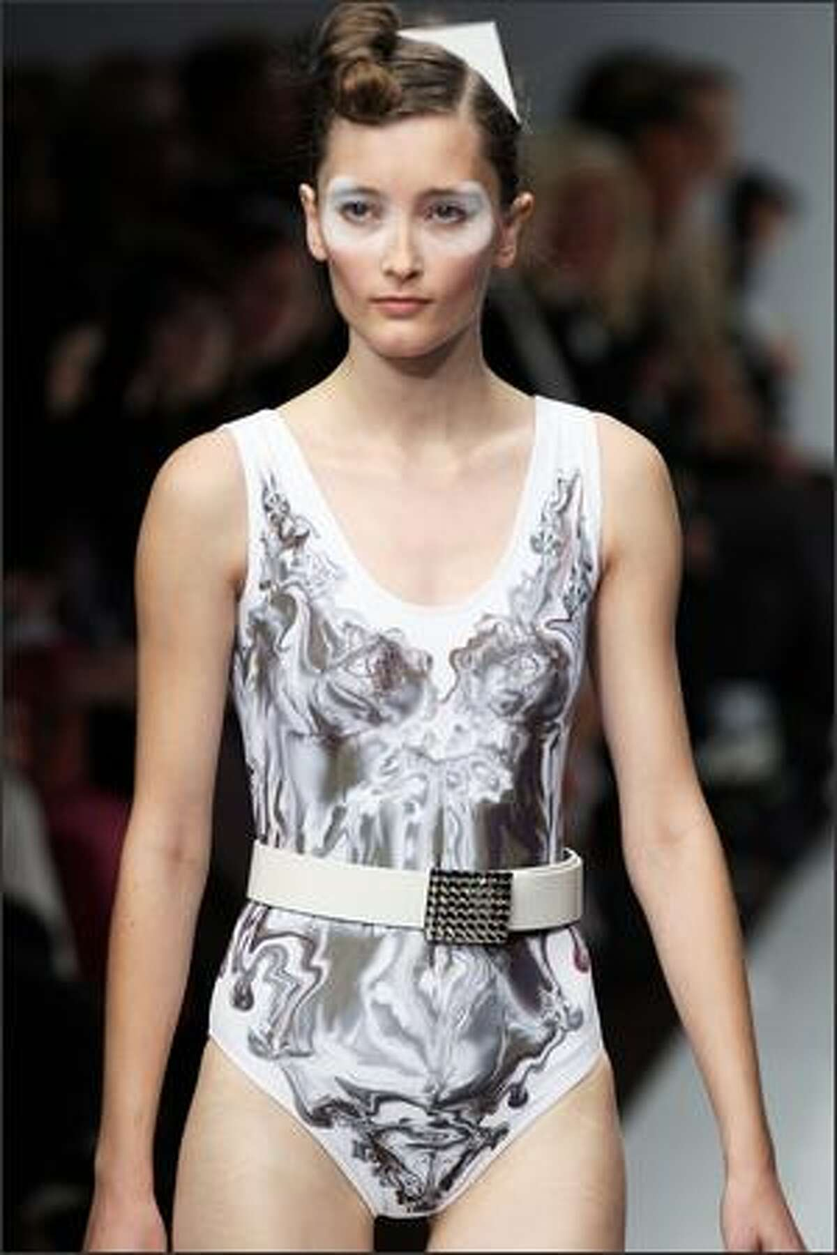 A model presents a creation by Rusian designer Igor Chapurin during Spring/Summer 2008 ready-to-wear collection show in Paris, 06 October 2007.
