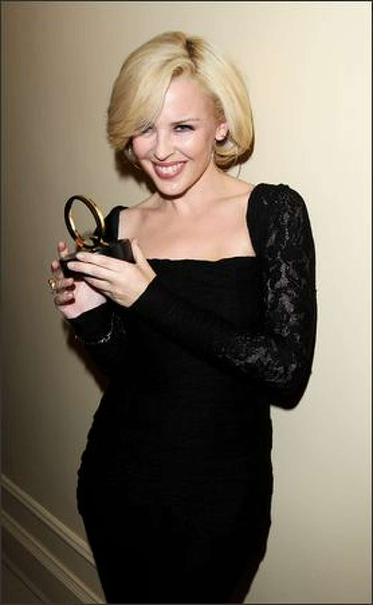 Kylie Minogue poses with the Q Idol award in the awards room at the Q Awards at the Grosvenor Hotel on October 8, 2007 in London, England.