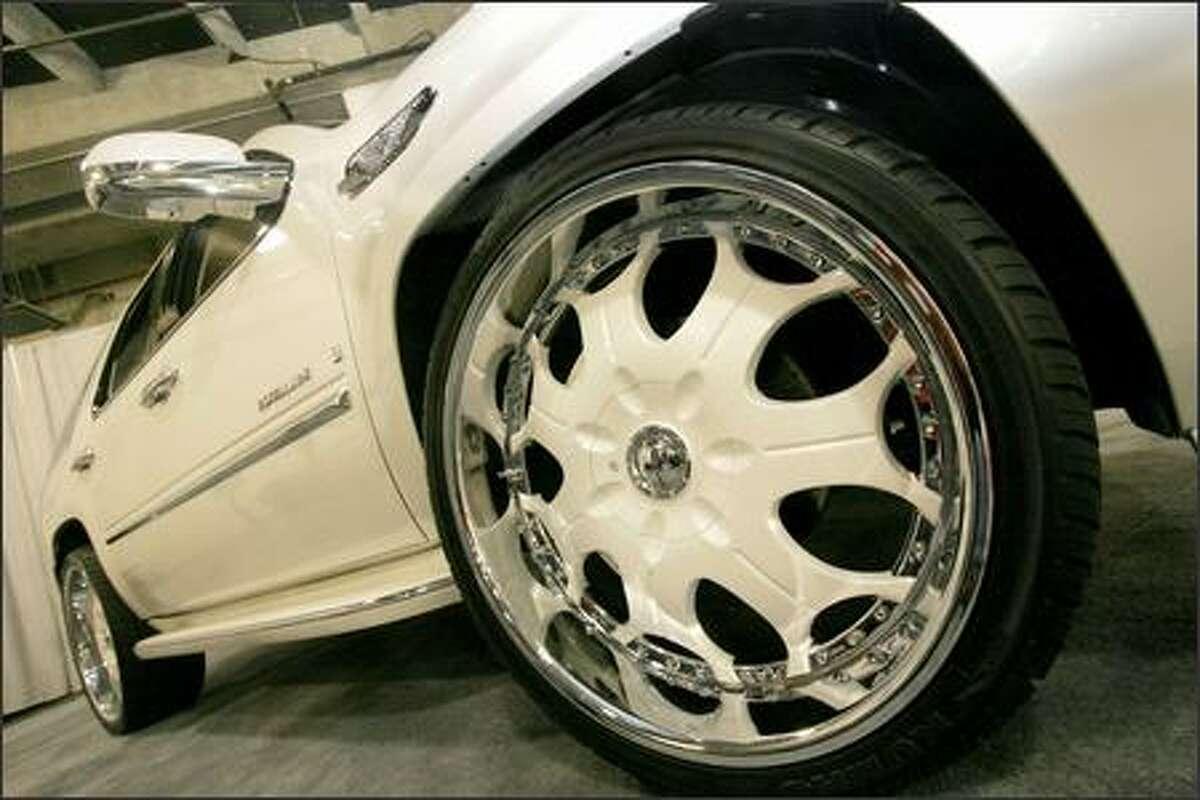 Car Nutz Customz displays 26-inch rims on a customized