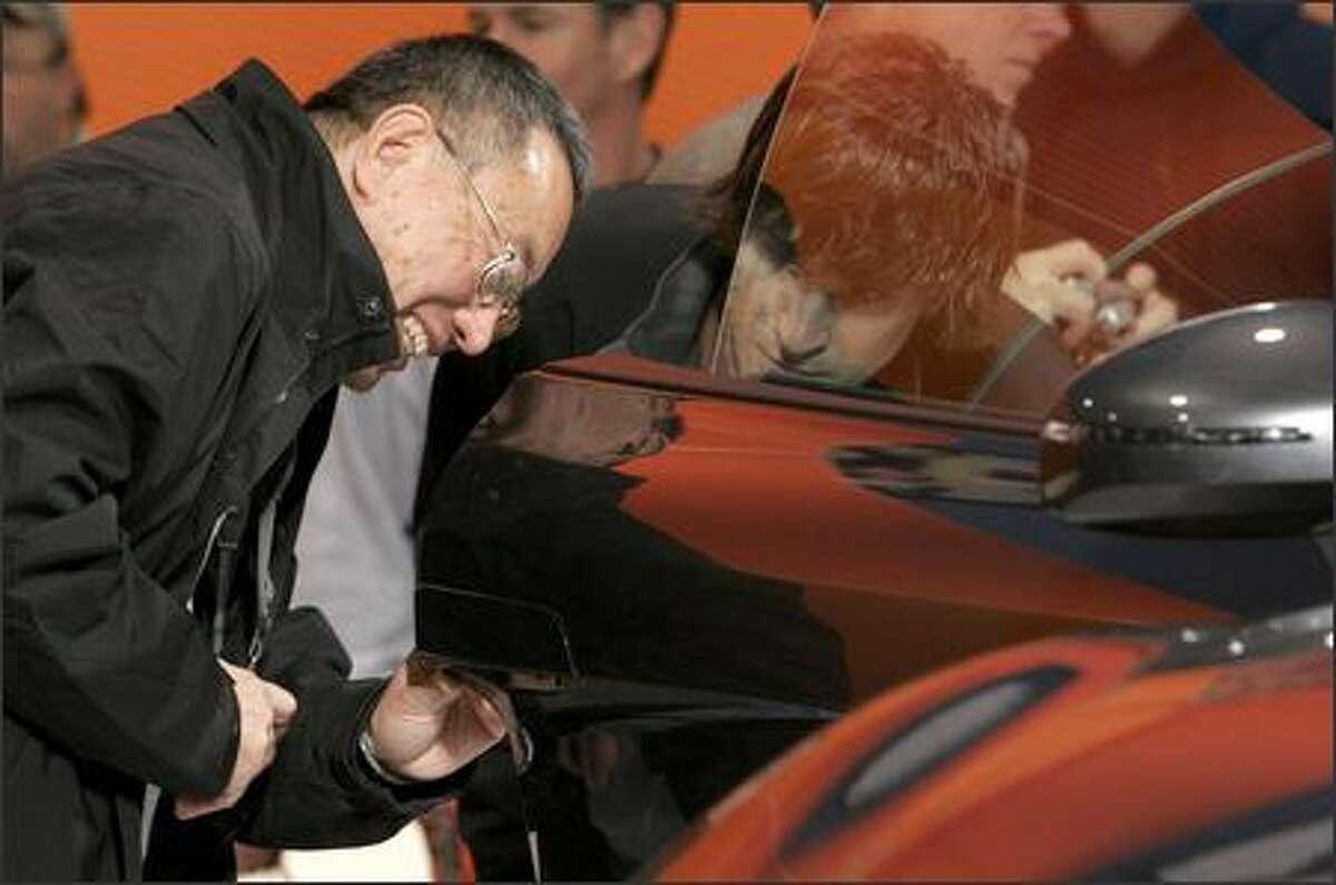Charles Lau, left, of Everett and Mitch Hettinger of Kirkland admire the 2008 Audi R8.