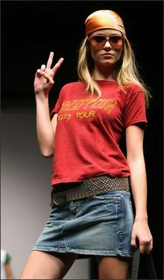 A model displays a vintage Led Zepellin 1973 tour T-shirt (estimated at $1,000-$1,500) during a show featuring Rock and Pop memorabilia at Christie's auction house in New York, Friday. Christie's will hold an auction of 292 lots of Rock and Pop Memorabilia on 30 November 2007, ranging from vintage T-shirts, autographed pictures, original music scores to musical instruments and Gold and Platinum albums. Photo: Getty Images