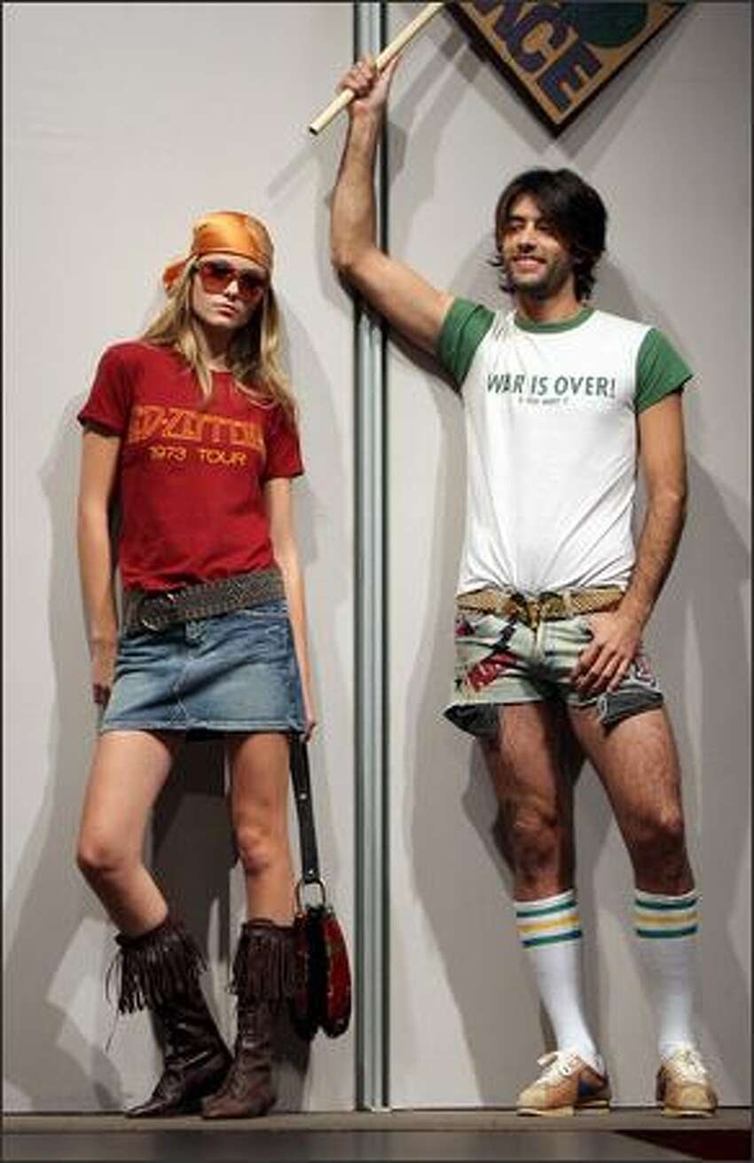 Models display vintage rock T-shirts during a show featuring Rock and Pop memorabilia at Christie's auction house in New York, Friday. Christie's will hold an auction of 292 lots of Rock and Pop Memorabilia on 30 November 2007, ranging from vintage T-shirts, autographed pictures, original music scores to musical instruments and Gold and Platinum albums. In this picture (L) Led Zepellin 1973 tour T-shirt ($1,000-$1,500) and (R) John Lenon and Yoko Ono