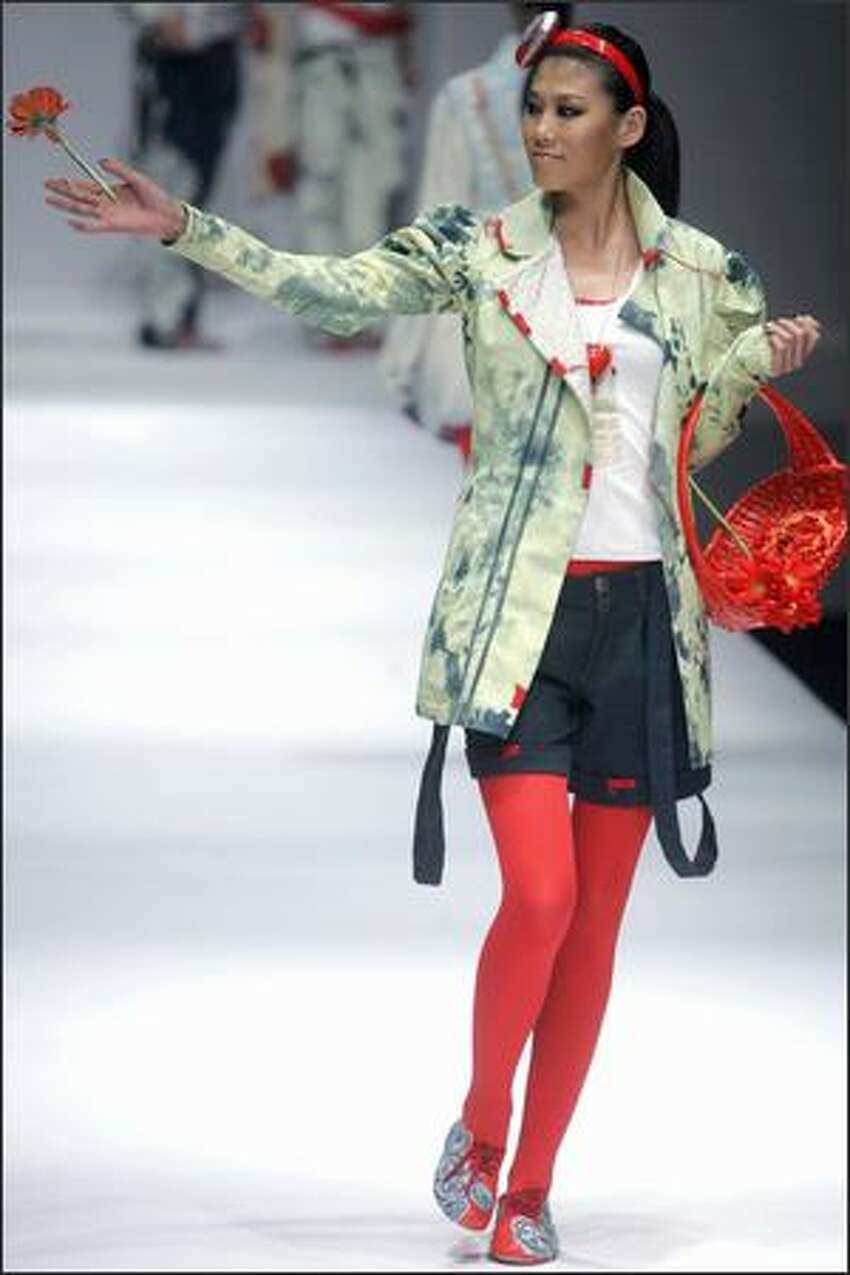A model parades a fashion from the BICT-Raffles Design Institute at the annual China Fashion Week in Beijing.