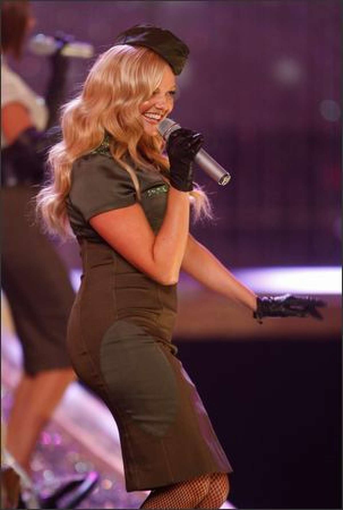 Singer Emma Bunton aka Baby Spice performs with the Spice Girls.