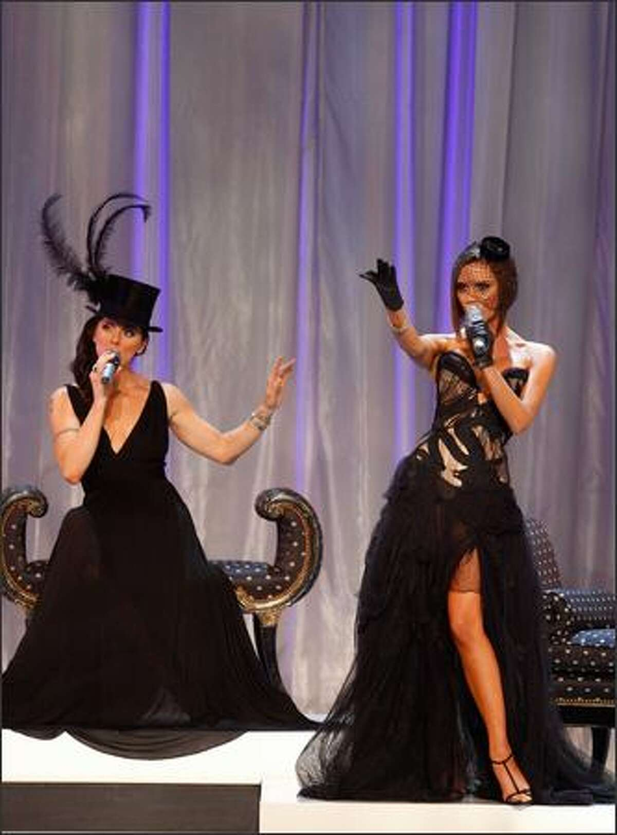 Singers Melanie Chisholm aka Sporty Spice (left) and Victoria Beckham aka Posh Spice perform with the Spice Girls.