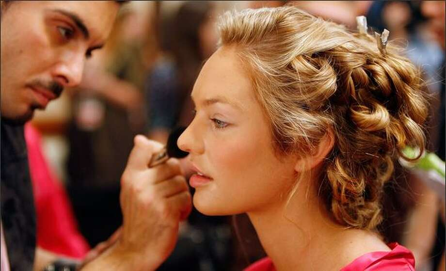 Model Candice Swanepoel prepares backstage before the Victoria's Secret Fashion Show at the Renaissance Hotel in Hollywood, California. Photo: Getty Images
