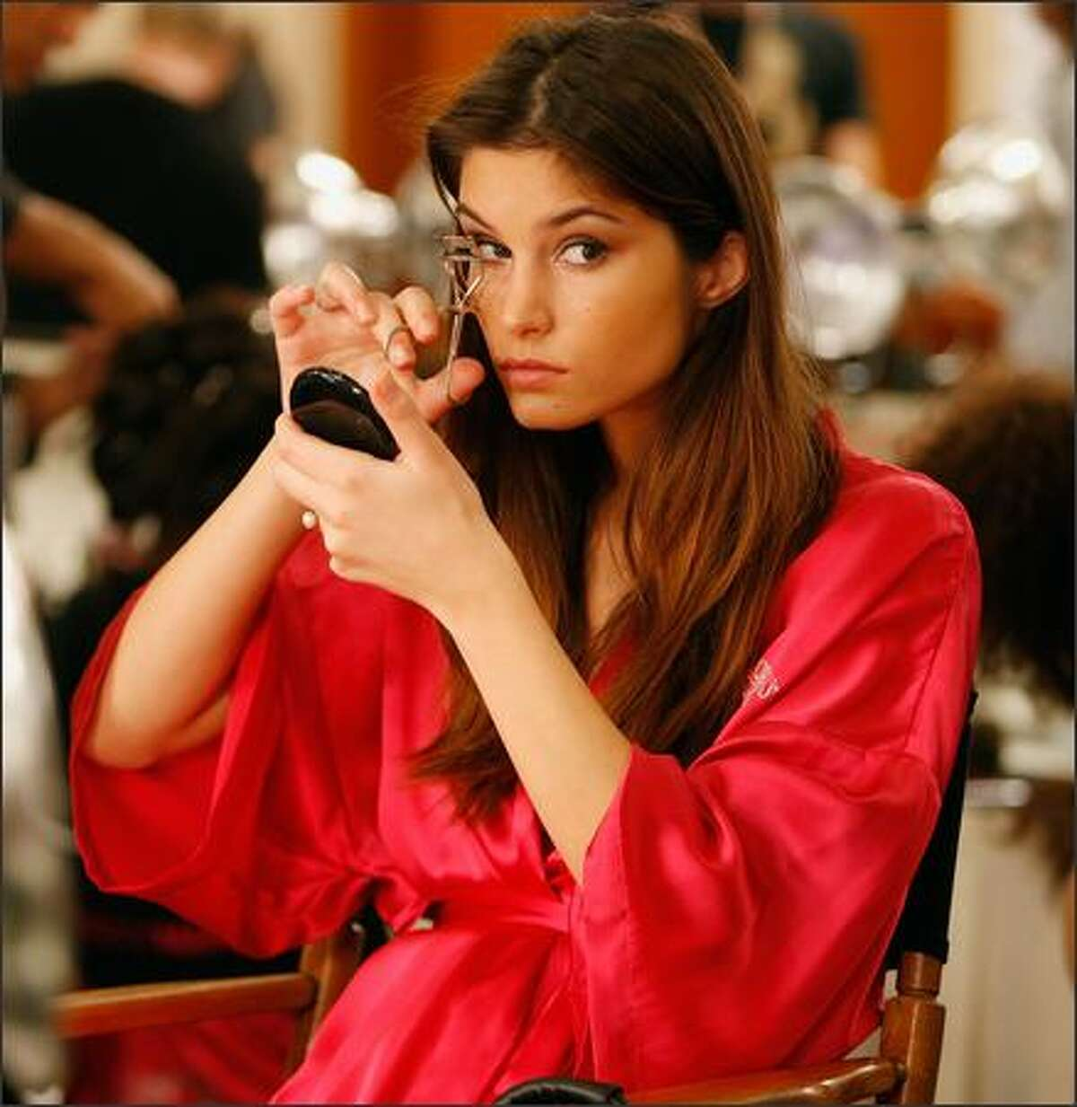 A model prepares backstage before the Victoria's Secret Fashion Show at the Renaissance Hotel in Hollywood, California.
