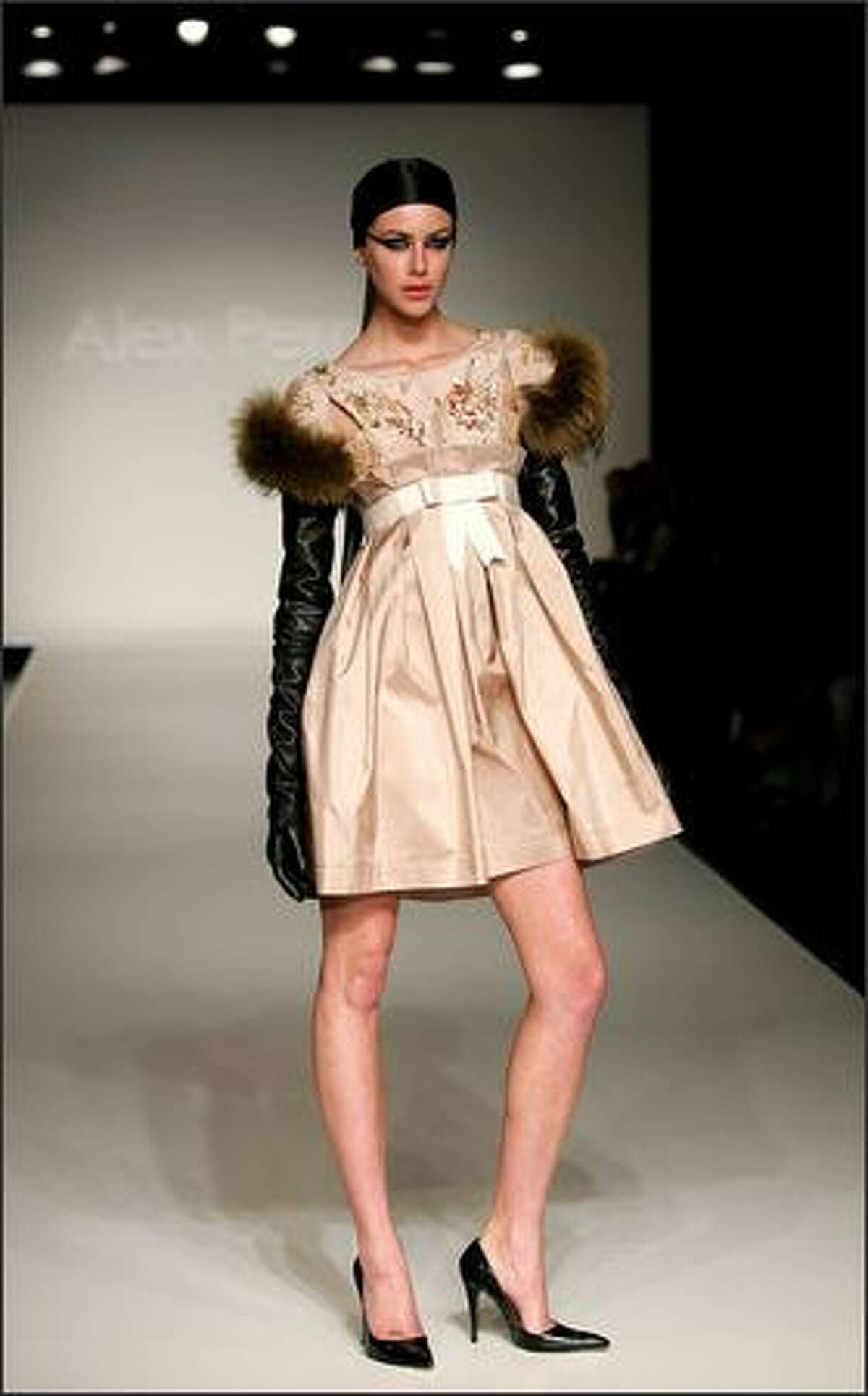 A model showcases designs on the catwalk by Alex Perry on the first day of Rosemount Australian Fashion Week's Transeasonal 2008 Collections, at the Overseas Passenger Terminal on October 9, 2007 in Sydney, Australia.