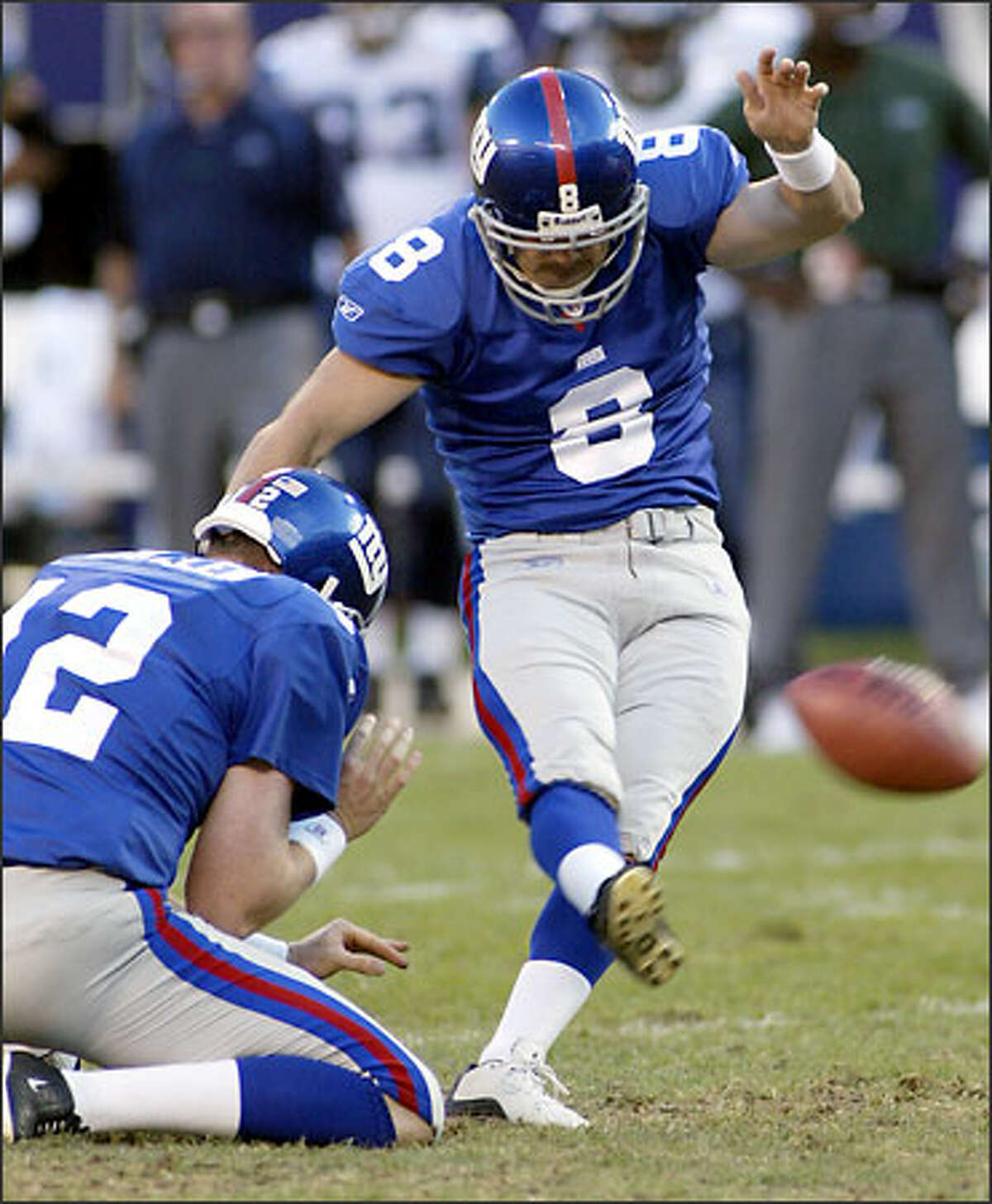 The Giants' Matt Bryant boots one of his three field goals, in the third quarter, for New York's lone points.