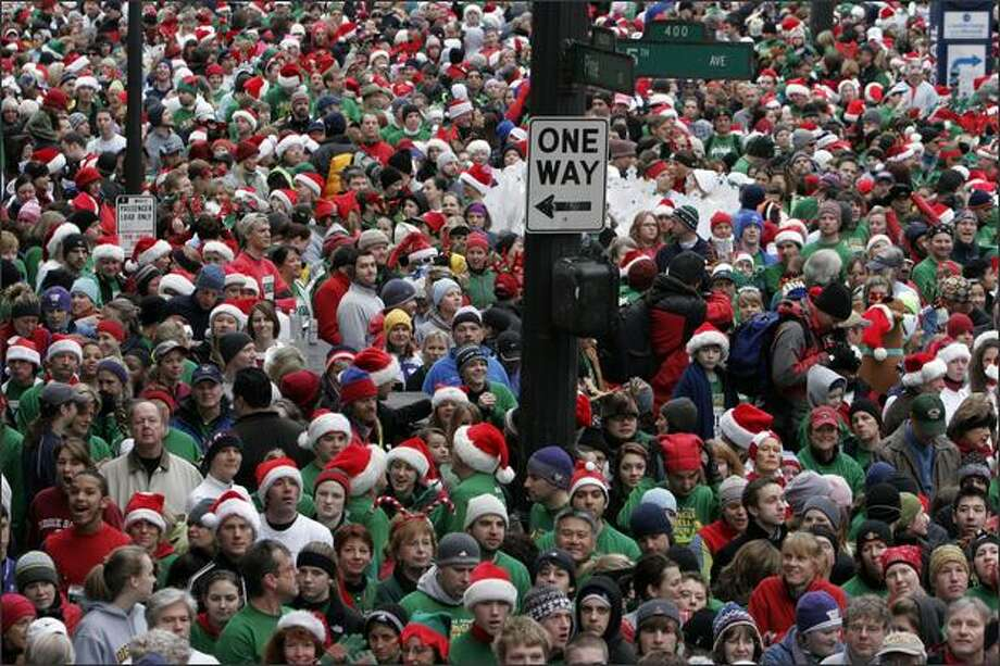 Over 11,000 runners and walkers participated in the 23rd Annual 5K Jingle Bell Run and Walk to benefit the Arthritis Foundation. The run began at 5th Ave. and Pine Streets in downtown Seattle. Photo: Meryl Schenker, Seattle Post-Intelligencer