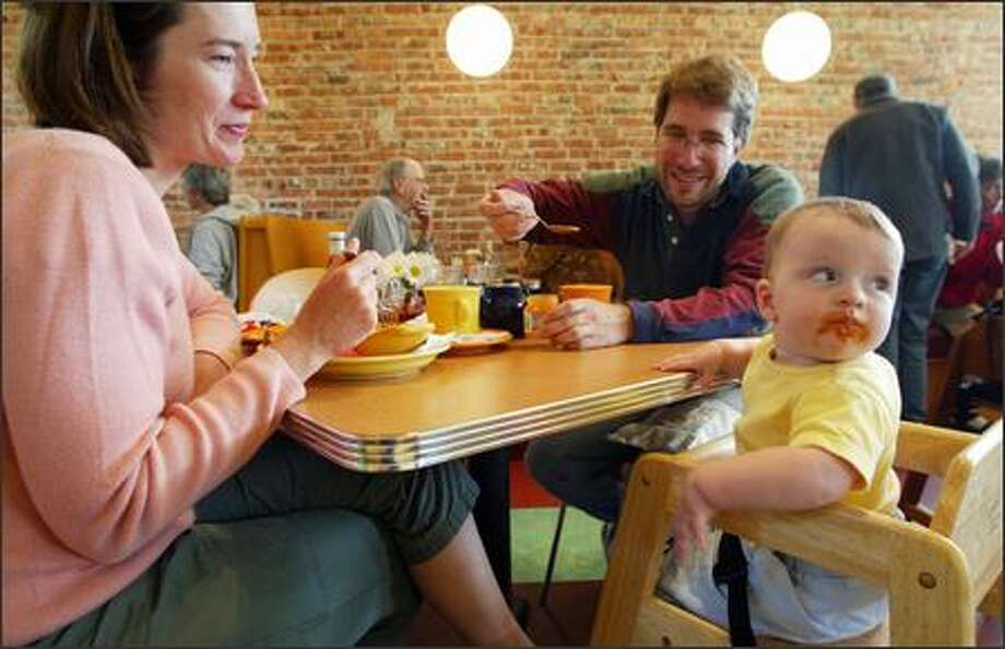 Susannah Merritt and her husband, Scott Barkar, enjoy breakfast with their daughter, Samantha, at Geraldine's Counter last Sunday. The Columbia City restaurant has been open for about two months and is already humming with locals and families Photo: Gilbert W. Arias/Seattle Post-Intelligencer
