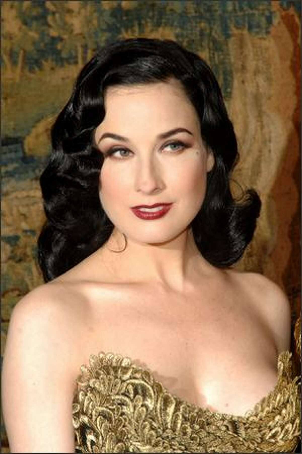 Performance artist Dita Von Teese attends the