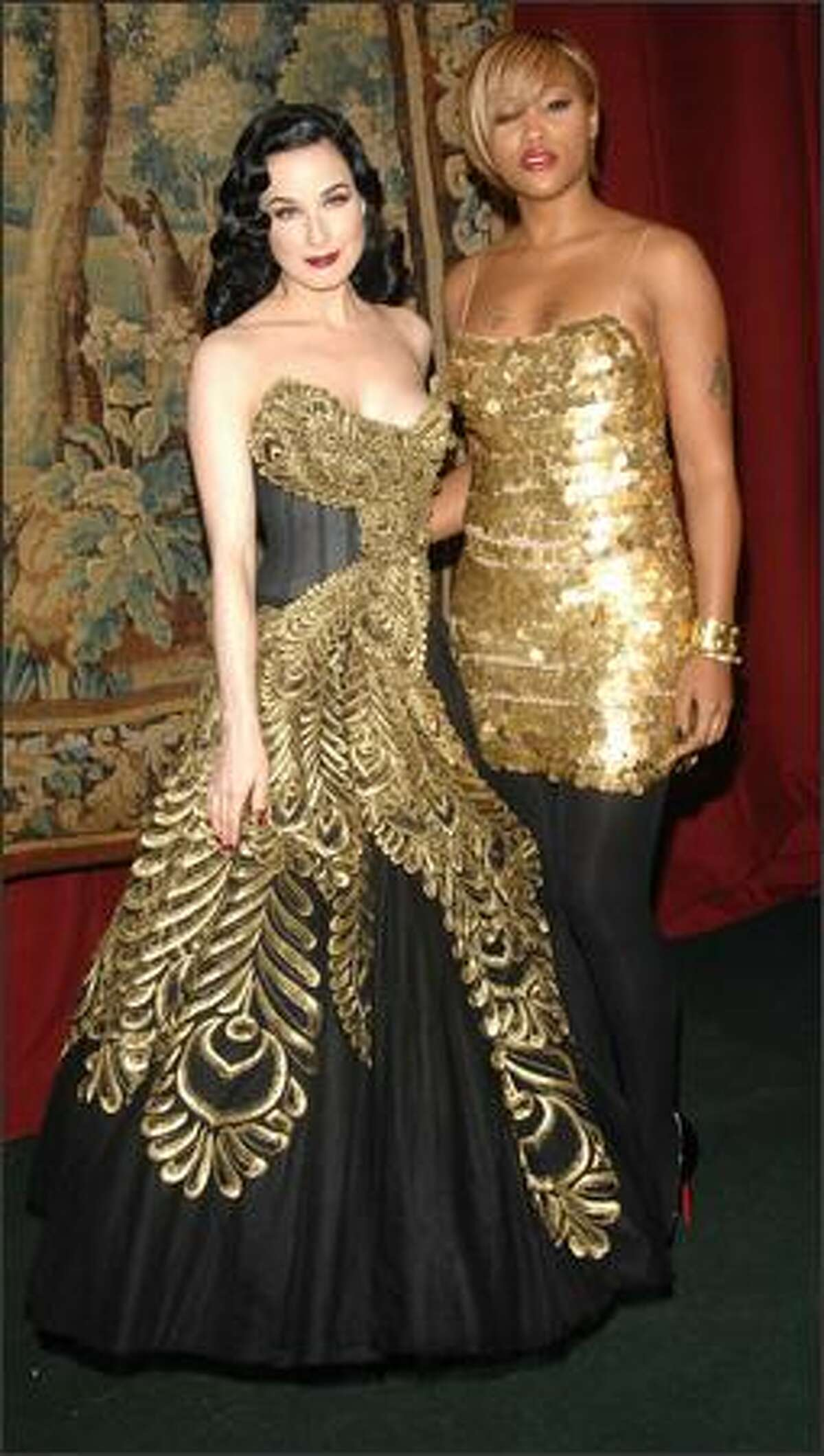 Performance artist Dita Von Teese (left) and musician Eve.