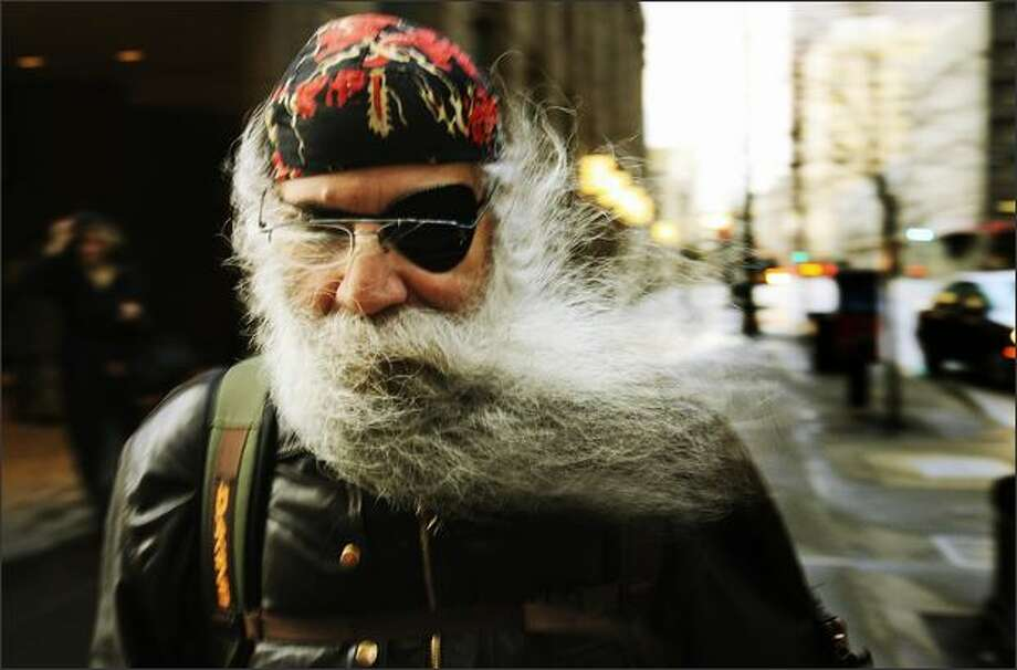 A strong gust of wind sends the beard of Frank Zamfino flying as he walks along Third Avenue in downtown Seattle. Photo: Dan DeLong, Seattle Post-Intelligencer