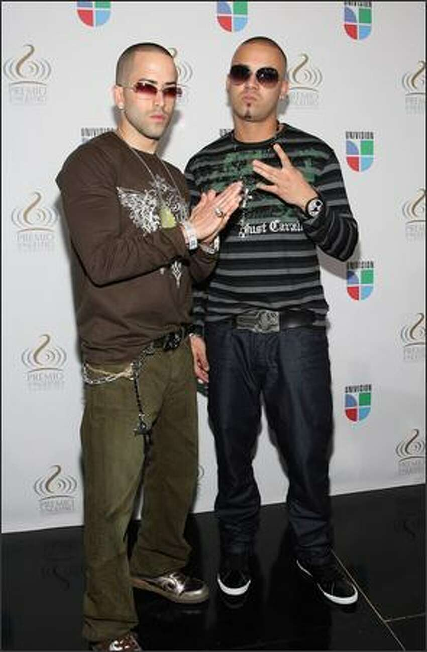 Recording artists Yandel and Wisin pose at Bongos Cuban Cafe during a press conference to announce the nominees for the 2008 Premio lo Nuestro a la Musica Latina awards show at the Bongos Cuban Cafe on December 12, 2007 in Miami, Florida.