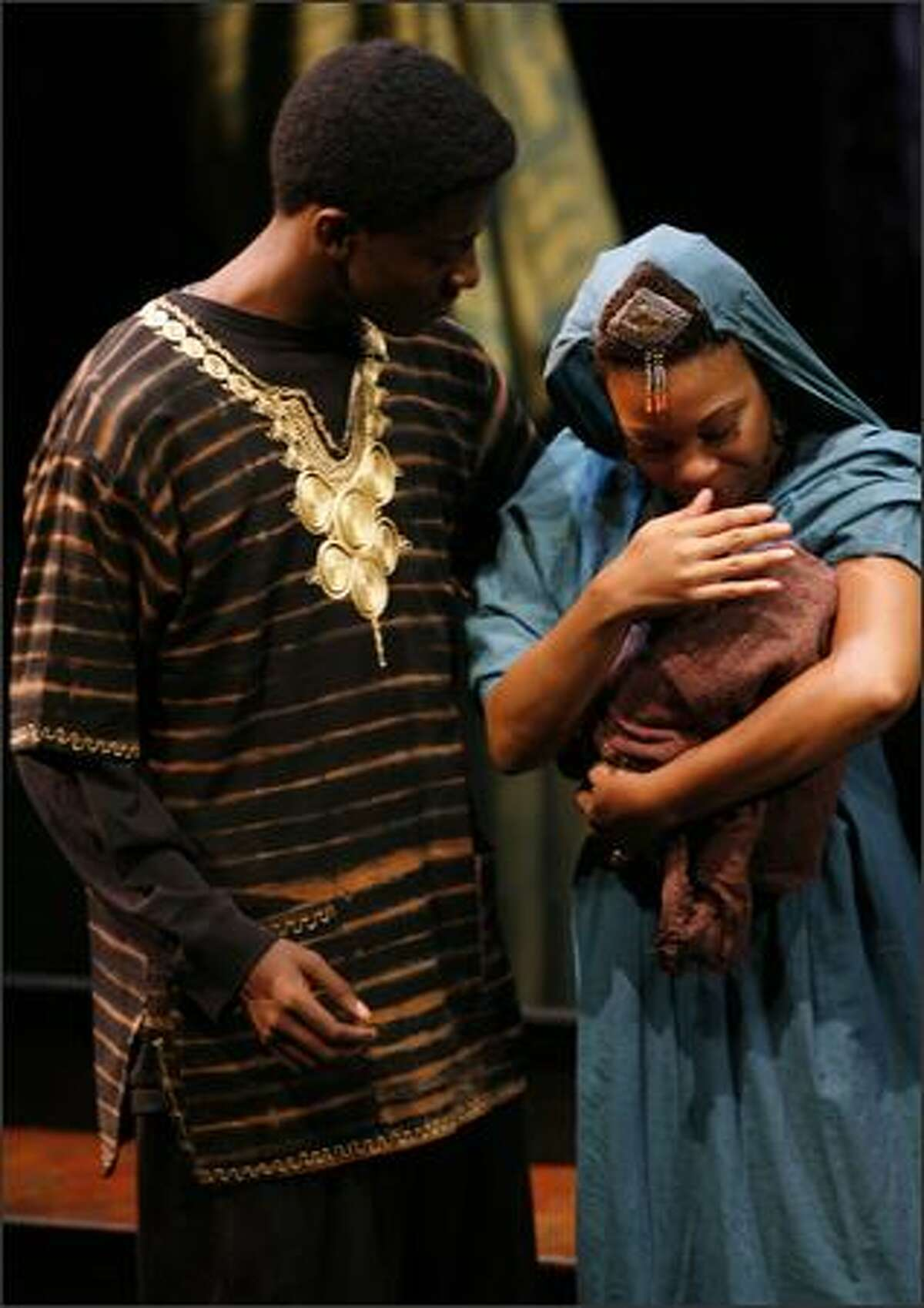 DeShe Brooks leans in to look at baby Jesus in Mary's (Erricka S. Davis) arm.