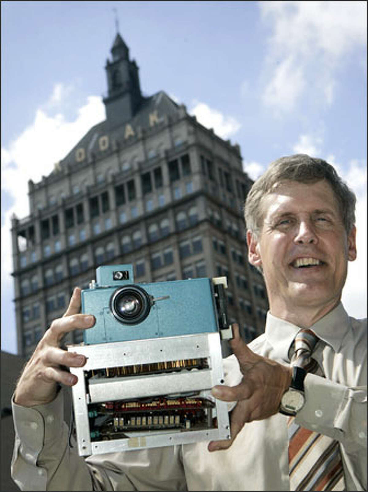 Steven Sasson holds the prototype digital camera he built in 1975 at the Eastman Kodak Co. headquarters in Rochester, N.Y. It recorded a black-and-white image on a digital cassette tape.
