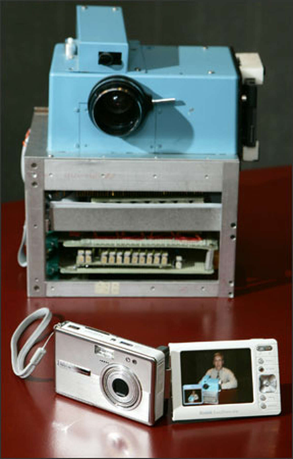 Kodak's latest digital camera, the EasyShare One, right, is much smaller than Sasson's prototype.