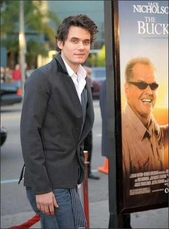 "Singer John Mayer arrives at the premiere of ""The Bucket List"" in Hollywood, California. The film is the story of two terminally ill men, Jack Nicholson and Morgan Freeman, escape from a cancer ward and head off on a road trip with a wish list of to-dos before they die. Photo: Getty Images"