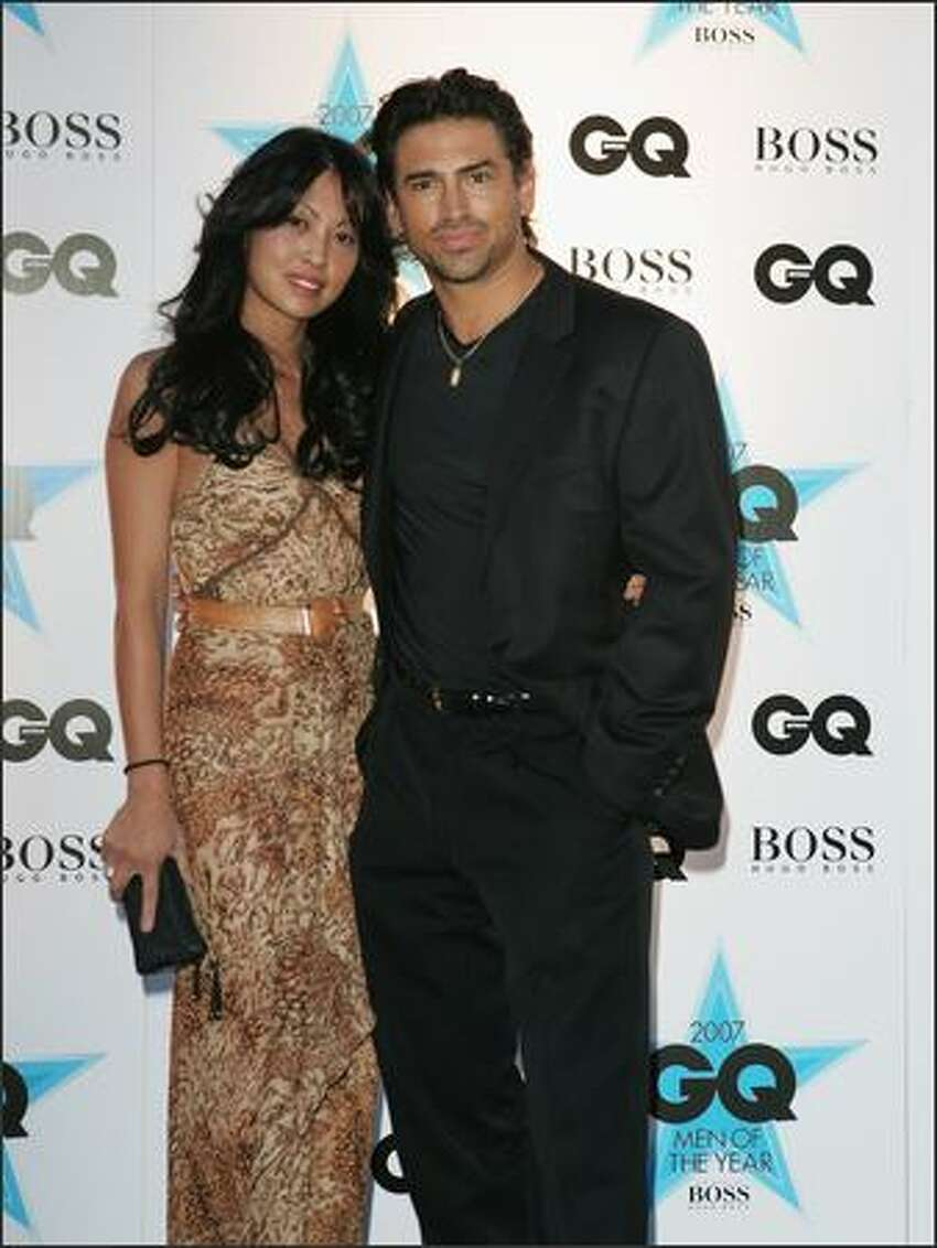 Cherri Tione and Justin Melvey attend the GQ Men of the Year Awards at Fox Studios on Tuesday in Sydney, Australia.