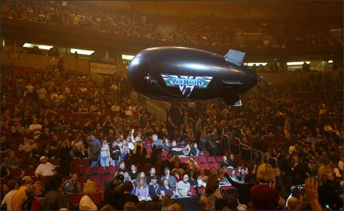 A Van Halen balloon flies over the crowd at Key Arena before the concert begins.