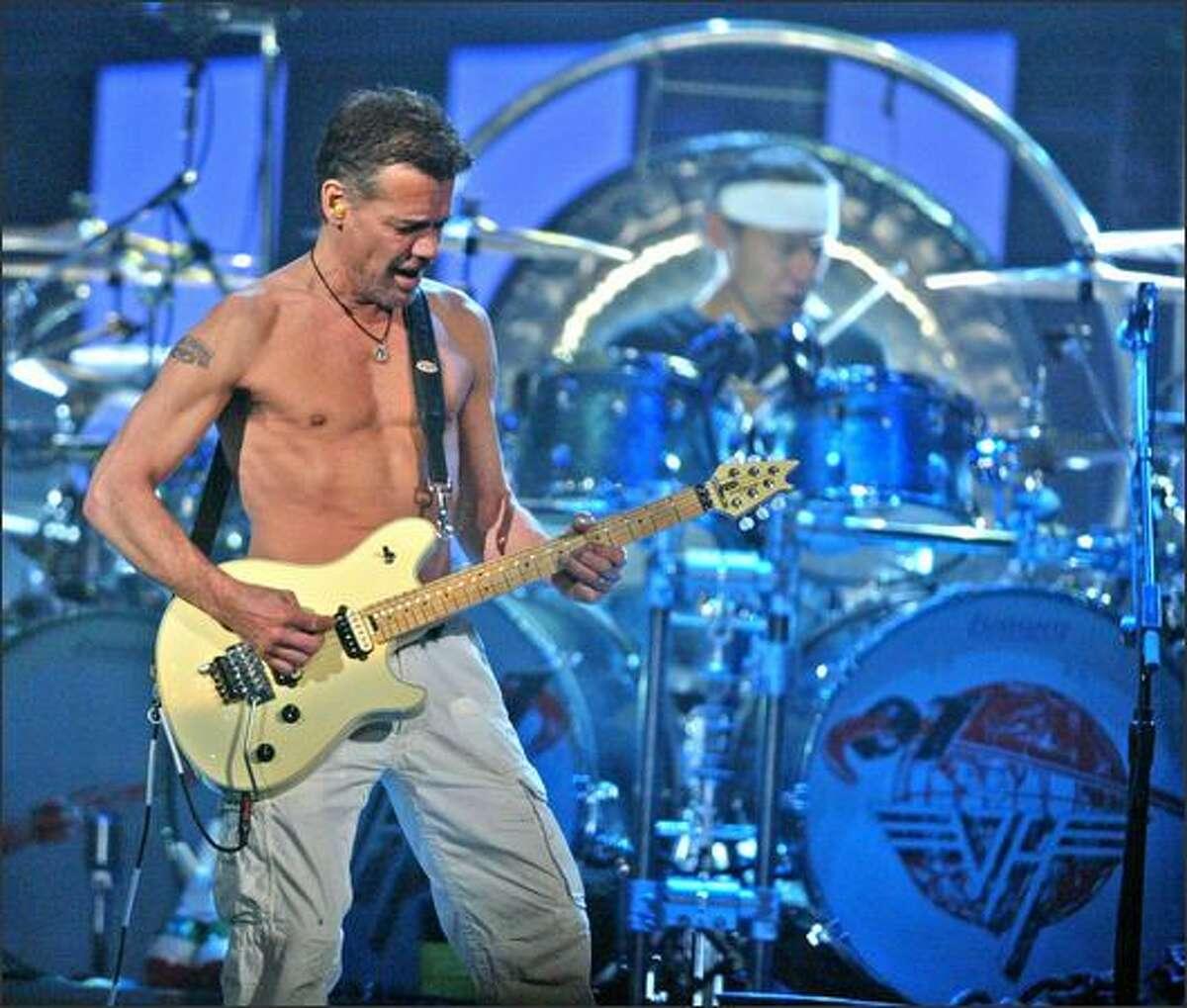 Eddie Van Halen, left, and his brother, Alex on the drums.
