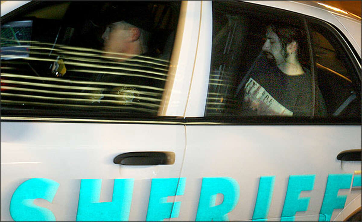Joseph Thomas McEnroe, one of the suspects in the Carnation-area killings, is driven to the King County Jail on Wednesday, Dec. 24, 2007.