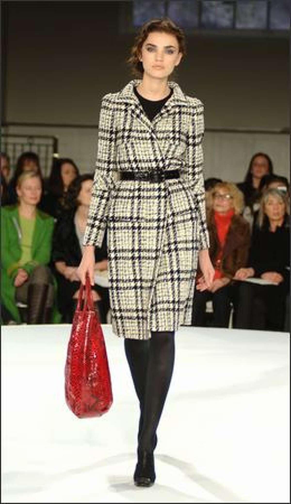 A model walks the runway at the Oscar de la Renta Pre-Fall 2008 Fashion Show on Monday in New York City.
